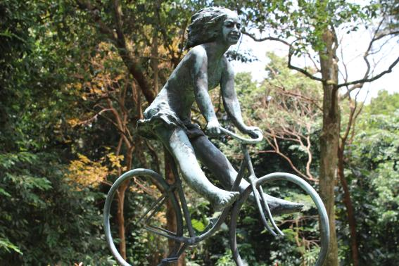 Girl on bike (bronze)