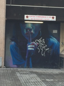 Street art on shop shutters in Barcelona
